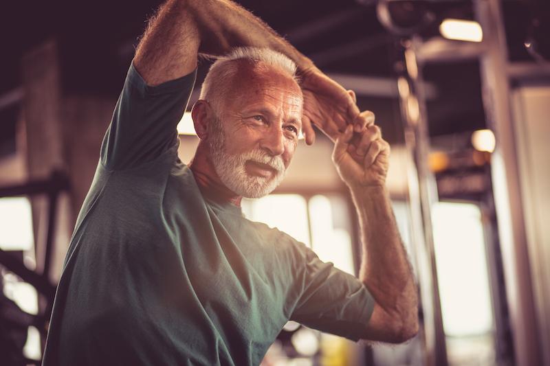 Senior man stretching