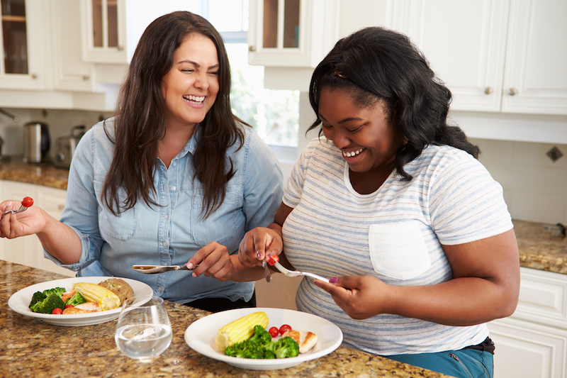 Two women eating healthy and enjoying it